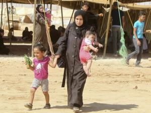 Mujer siria en campo de refugiados