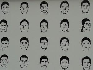 Fragmento de mural de Amnistía Internacional con los rostros de los desaparecidos